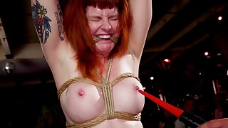 Naughty redhead Arabelle Raphael tortured next to her friends