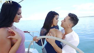 Intense threesome during sexual boat trip with twosome Latina women