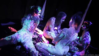 Wondrous bitches covered with luminous paint masturbate wet pussies
