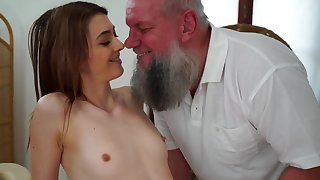 Teen cutie is stroking and sucking age-old cadger on the massage table