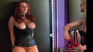 Curvy slave gets pressed by a professional MILF dominatrix Nina Hartley